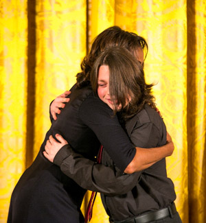 Lukas from Provincetown Art Association and Museum hugs First Lady Michelle Obama. Photo by Ralph Alswang.