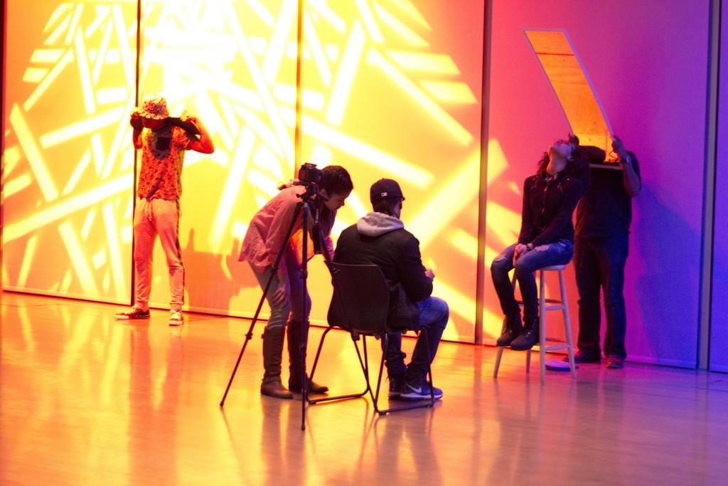 ICA Teen Digital Photography students taking portrait photos of ICA Teen Slam Team, December 2014. Photo by Angela Mittiga.