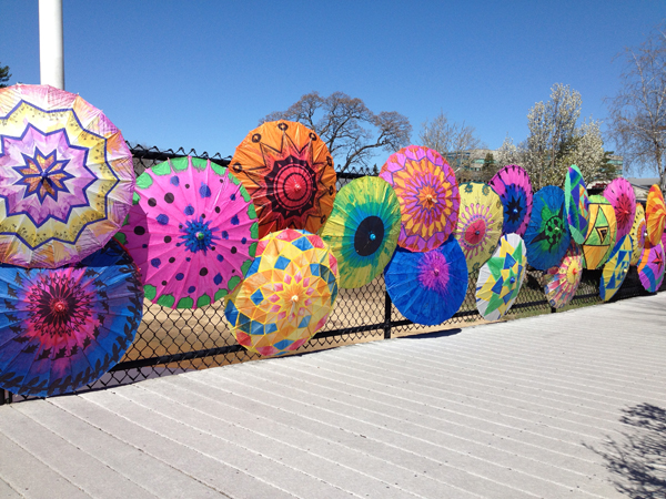 Hand-painted parasols installed in Beverly, MA.