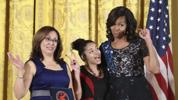Inquilinos Boricuas en Acción's (IBA) CEO Vanessa Calderón-Rosado receiving the 2016 National Arts and Humanities Youth Award from First Lady Michelle Obama alongside Noemí Negron.
