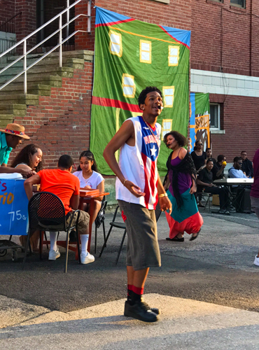 Young man singing in Hyde Square Task Force's El Barrio! musical. Photo by Jessica Guzman.