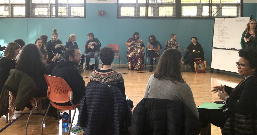 Participants seated in a circle at a BEST Initiative training